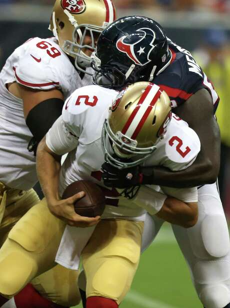 Texans outside linebacker Whitney Mercilus (59) made two big plays on the same first-half series, including this sack of San Francisco quarterback Blaine Gabbert (2)  on Thursday night at NRG Stadium. Photo: Brett Coomer, Staff / © 2014  Houston Chronicle