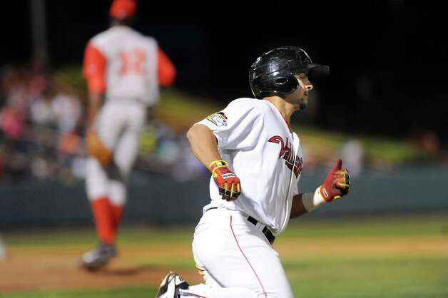 ValleyCats' Alex Hernandez, right, runs to first during their baseball game against the Brooklyn Cyclones on Thursday, Aug. 28, 2014, at Bruno Stadium in Troy, N.Y. (Cindy Schultz / Times Union) Photo: Cindy Schultz / 00028316A