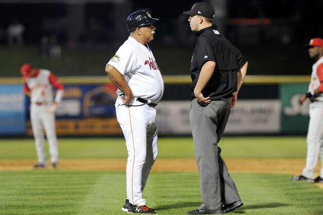 ValleyCats' coach Ed Romero, left, disputes a call with an official when he calls Alex Hernandez out after a dive back to first during their baseball game against the Brooklyn Cyclones on Thursday, Aug. 28, 2014, at Bruno Stadium in Troy, N.Y. (Cindy Schultz / Times Union) Photo: Cindy Schultz / 00028316A