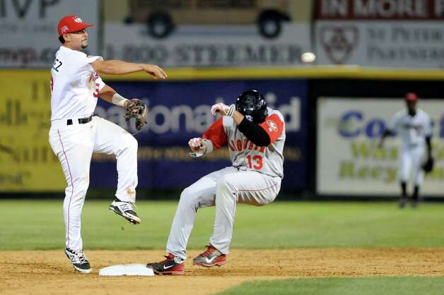 ValleyCats' Alex Hernandez, left, gets Cyclones' Jhoan Urena out at first and tries for a double play during their baseball game against the Brooklyn Cyclones on Thursday, Aug. 28, 2014, at Bruno Stadium in Troy, N.Y. (Cindy Schultz / Times Union) Photo: Cindy Schultz / 00028316A