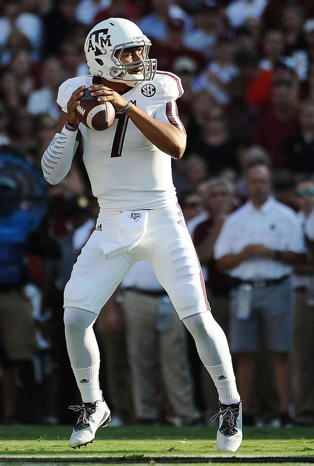 Texas A&M quarterback Kenny Hill (7) looks to pass against South Carolina during the first half of an NCAA college football game on Thursday, Aug. 28, 2014, in Columbia, S.C. (AP Photo/Rainier Ehrhardt) ORG XMIT: SCRE115 Photo: Rainier Ehrhardt / FR155191 AP