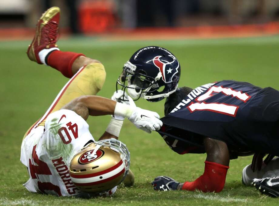 49ers 40, Texans 13  Texans wide receiver Uzoma Nwachukwu loses his helmet on a punt return during the fourth quarter. Photo: Brett Coomer, Houston Chronicle
