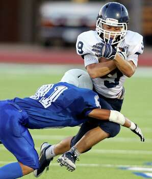 Central Catholic's Jimin Suh looks for room around Lanier's Juan Palomino during first half action Thursday Aug. 28, 2014 at Alamo Stadium. Photo: Edward A. Ornelas, San Antonio Express-News / © 2014 San Antonio Express-News