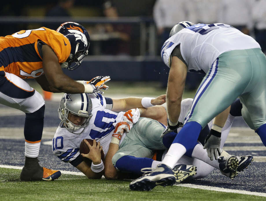 Reserve quarterback Dustin Vaughan is sacked during the Cowboys' final preseason game. Dallas finished winless in the exhibitions for the fifth time in franchise history. Photo: LM Otero / Associated Press / AP