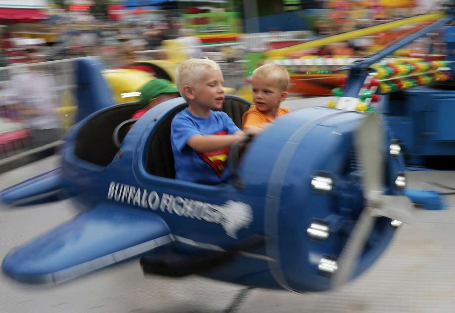We're losing altitude! Possibly because the wings are so small!The young pilot and copilot of a Bomb Divers plane fly in circles at the Minnesota State Fair in Falcon Heights. Photo: Jim Mone, Associated Press