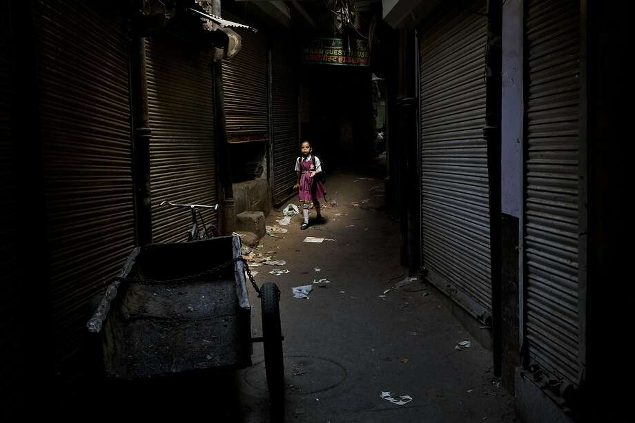 An Indian schoolgirl walks through an alley in New Delhi, India, Thursday, Aug. 28, 2014. (AP Photo/Bernat Armangue) Photo: Bernat Armangue, Associated Press