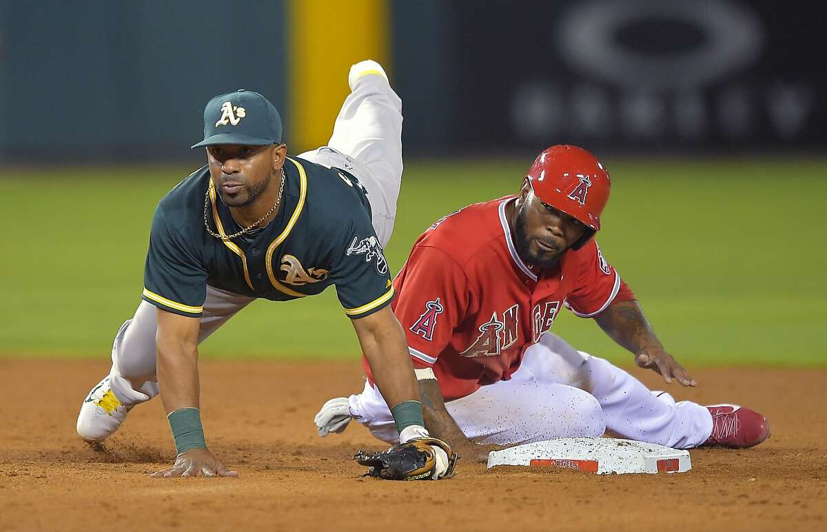 Los Angeles Angels' Howie Kendrick, right, and Oakland Athletics second baseman Alberto Callaspo watch Callaspo's throw to first that completed a double play on David Freese during the sixth inning of a baseball game, Thursday, Aug. 28, 2014, in Anaheim, Calif. (AP Photo/Mark J. Terrill)