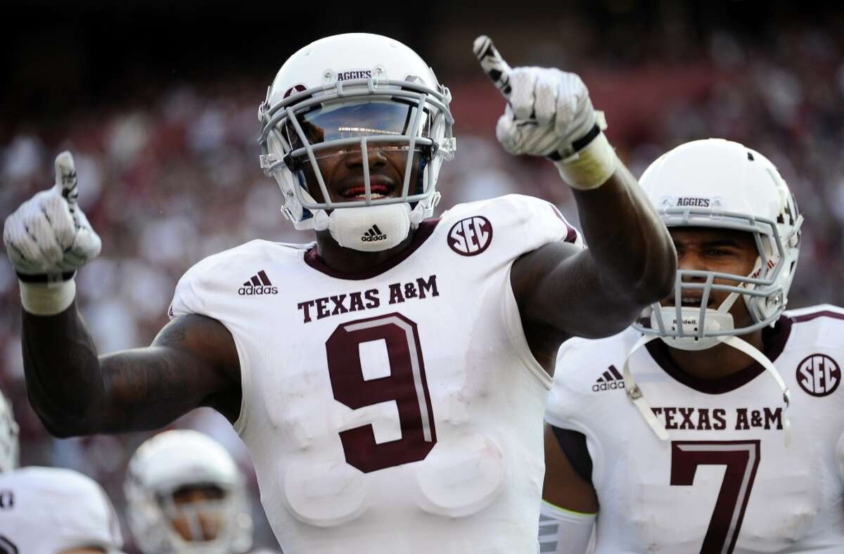 Texas A&M wide receiver Ricky Seals-Jones (9) celebrates with teammate Kenny Hill (7) after scoring a touchdown.