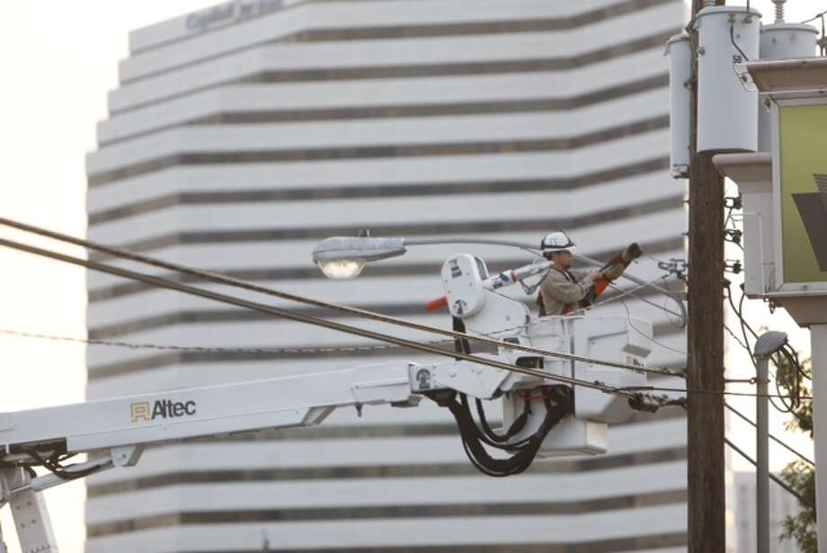 Traffic was disrupted early Friday morning after a crash in the Galleria left a power pole splintered and leaning above a roadway. Photo: Cody Duty / Houston Chronicle
