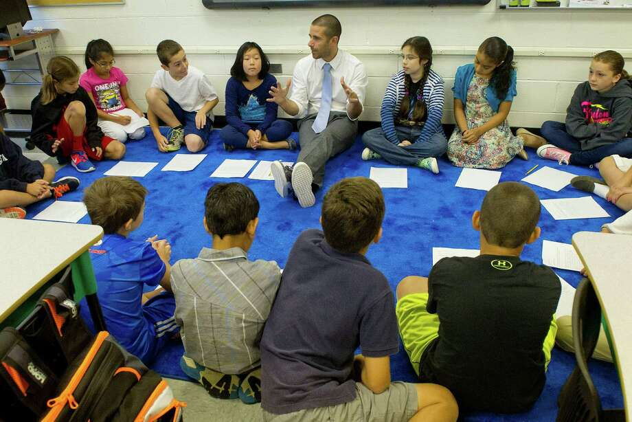 Jimmy Sapia teaches fifth grade at Rippowam Middle School on Friday, August 29,2014, as part of a voluntary magnet program to help reduce overcrowding at the city's elementary schools. Photo: Lindsay Perry / Stamford Advocate