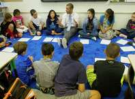 Jimmy Sapia teaches fifth grade at Rippowam Middle School on Friday, August 29,2014, as part of a voluntary magnet program to help reduce overcrowding at the city's elementary schools.