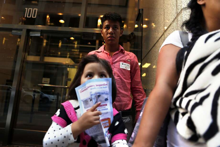 After his first hearing, Eduardo Morales, 17, an unaccompanied minor who entered the US illegally from El Salvador, waits for a ride outside immigration court on Montgomery Street  in San Francisco, Calif., with his cousin Angely Garcia, 6, (bottom) and another cousin's wife, Jessica Martinez, on Tuesday, August 26, 2014. Photo: Scott Strazzante, The Chronicle