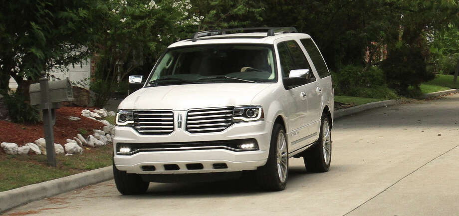 "Lincoln's new 2015 Navigator boasts a split-wing grille and puddle lamps that create a ""welcome mat"" below front doors. / (c) Jeff Yip, 2013 All rights reserved"