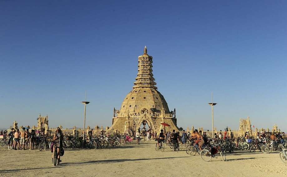 In this Aug. 23, 2014 photo, Burning Man participants gather at the Temple of Grace at the annual Burning Man event on the Black Rock Desert of Gerlach, Nev.  Photo: Andy Barron, Associated Press