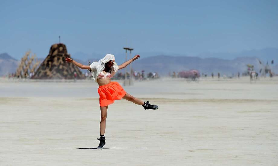 In this Aug. 27, 2014 photo, Franziska Goltz dances on the playa at Burning Man on the Black Rock Desert of Gerlach, Nev. Organizers call Burning Man the largest outdoor arts festival in North America, with its drum circles, decorated art cars, guerrilla theatrics and colorful theme camps.  Photo: Andy Barron, Associated Press