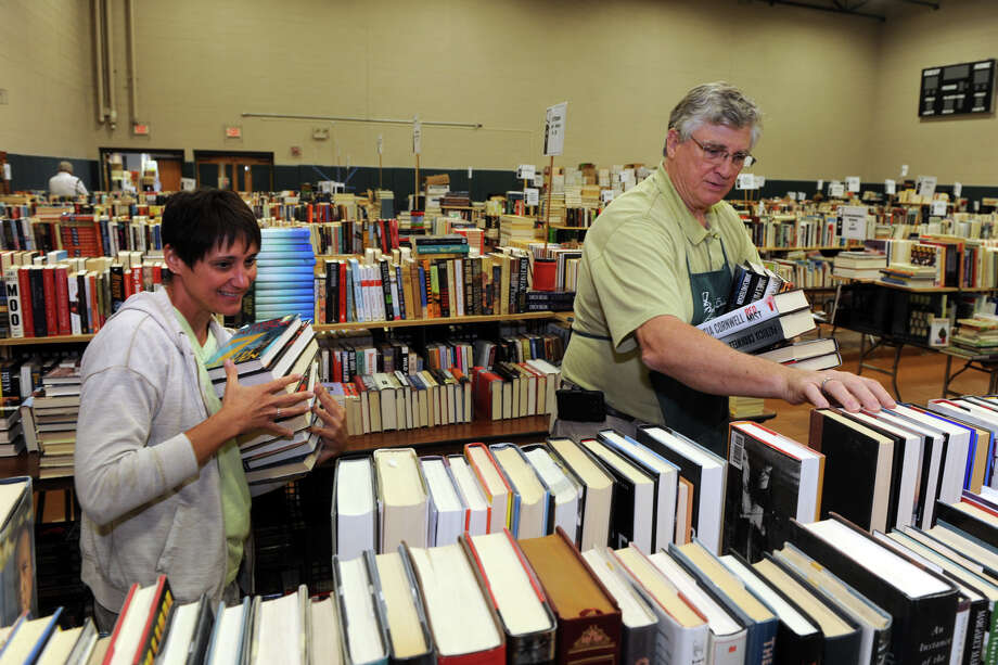 Volunteers Sandi O'Reilly and Thom Field sort books as they and others prepare for the 54th Annual Mark Twain Library Book Fair, at the Redding Community Center in Redding, Conn. Aug. 28, 2014. The fair opens Friday morning, and continues from 9am through 4pm each day until Monday. Photo: Ned Gerard / Connecticut Post