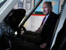 Igor Sikorsky Jr. sits in the cockpit of a S-76 helicopter Thursday, Aug. 28, 2014 at the National Helicopter Museum in Stratford, Conn. His father, Igor Sikorsky Sr., built the world's first working helicopter.