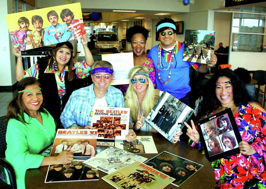 Committee members, staff, and volunteers are all ready for the 40th annual Groovy Party, as are honorary chairs Ron and Juliana Ewer of Legacy Ford.  Seated, from left are Manuela Arroyos, Fort Bend Seniors CEO; Ron and Juliana Ewer; and Cyndia Rodriguez.  Standing are Eloise Lucas; Katie Herrington; Ray Aguilar, board of directors chair; and Cyndia Rodriguez. Photo: Courtesy Fort Bend Seniors Meals / ONLINE_YES