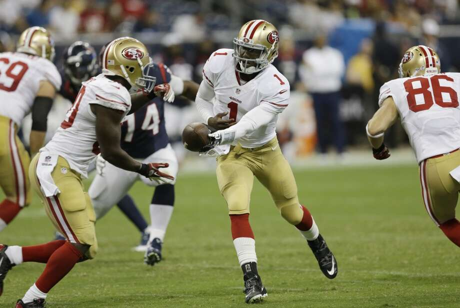 San Francisco 49ers' Josh Johnson hands off during the third quarter of a preseason game against the Houston Texans on Aug. 28. Photo: David J. Phillip, Associated Press