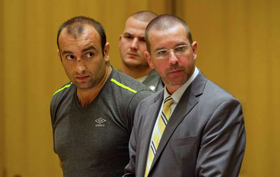 Shota Mekoshvili, with his attorney Lindy Urso in State Superior Court in Stamford, Conn., on Friday, August 29, 2014. Mekoshvili is accused of murdering Mohammed Kamal, the Stamford Taxi driver found near his cab on Doolittle Road earlier this week. Photo: Lindsay Perry / Stamford Advocate
