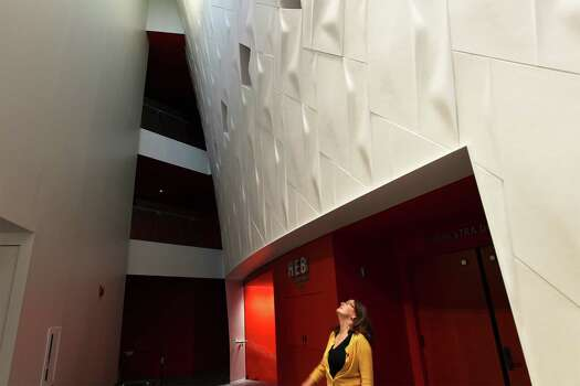 Marmon Mok Architecture Associate Partner Mary Bartlett takes in a view of the grand lobby in the Interior of the Tobin Center for the Performing Arts on Tuesday, August 12, 2014. Photo: Kin Man Hui, San Antonio Express-News / ©2014 San Antonio Express-News