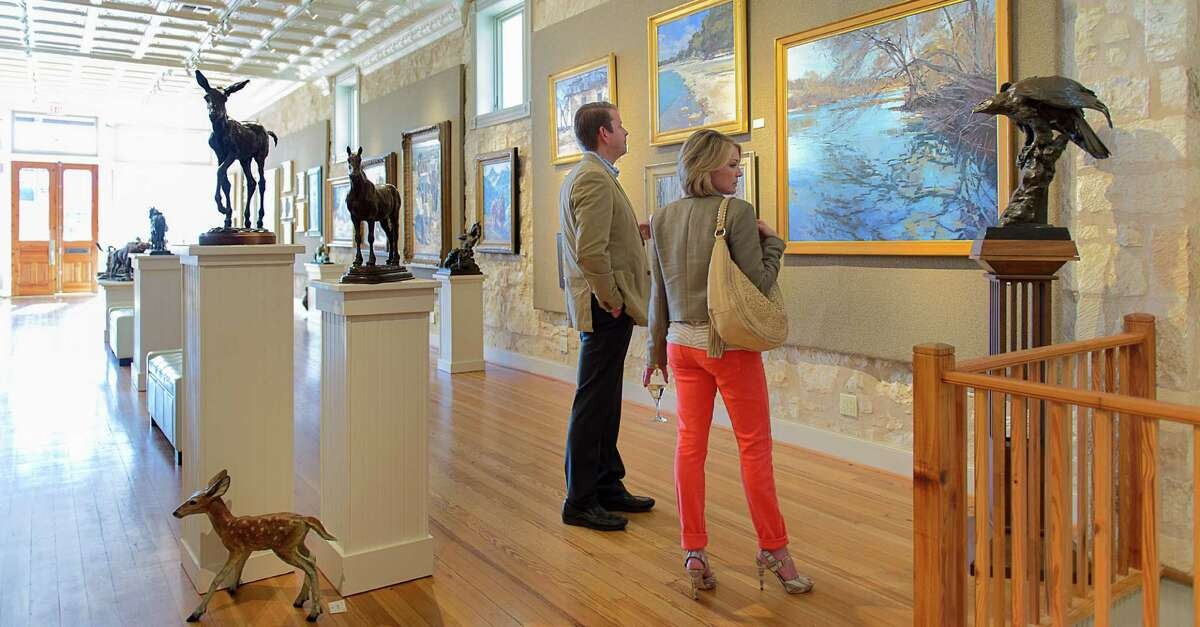 Visitors to InSight Gallery in Fredericksburg find soothing landscapes and nature scenes amid animal and western-themed sculptures.