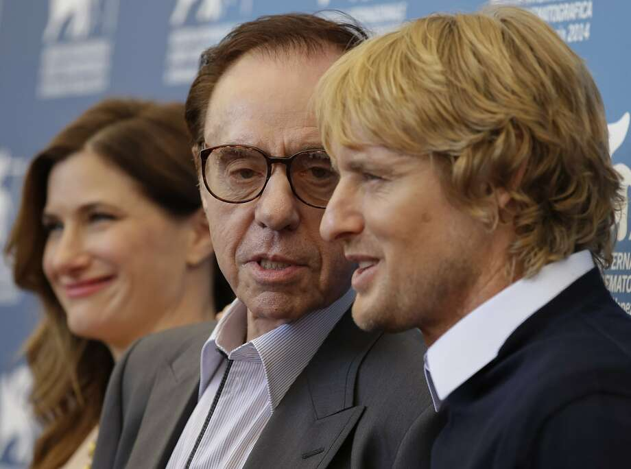 From left, actress Kathryn Hahn, director Peter Bogdanovich, and actor Owen Wilson pose during the photo call for the movie She's Funny That Way at the 71st edition of the Venice Film Festival in Venice, Italy, Friday, Aug. 29, 2014. (AP Photo/Andrew Medichini) Photo: Andrew Medichini, Associated Press