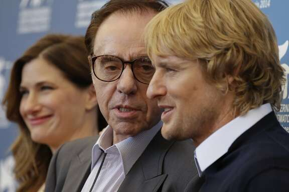 From left, actress Kathryn Hahn, director Peter Bogdanovich, and actor Owen Wilson pose during the photo call for the movie She's Funny That Way at the 71st edition of the Venice Film Festival in Venice, Italy, Friday, Aug. 29, 2014. (AP Photo/Andrew Medichini)