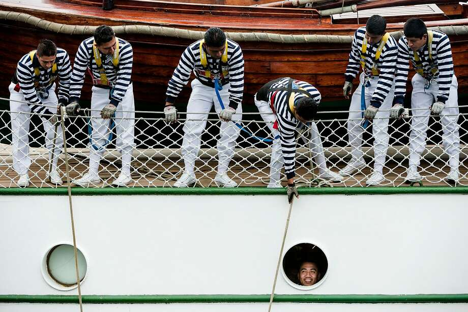 "Who let him out of the bilge?Sailors prep the Mexican Navy Tall Ship Cuauhtemoc for the dock after arriving in Seattle as part of its ""America 2014"" voyage. Photo: Jordan Stead, Associated Press"
