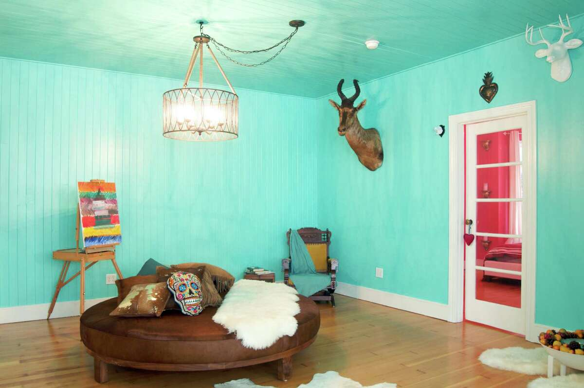 Bright loft in SOMA San Francisco; $135 per nightBold is an understatement for this loft. The main room is turquoise, with realistic and faux deer heads, while the bedroom is pink. There's four-side sun exposure, a private deck, fireplace, and queen bed.