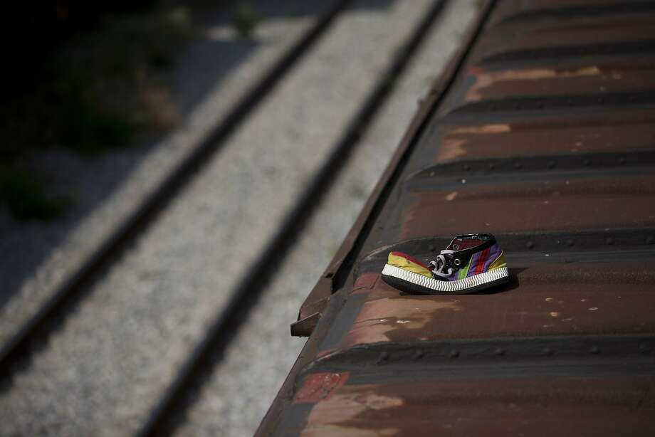 America needs to protect its borders from clown migrants taking local clown jobs from those who stuff tiny cars for a living:A clown shoe belonging to a Honduran migrant lies atop a freight train after a night raid staged by local authorities in Ixtepec, Mexico. Photo: Rebecca Blackwell, Associated Press