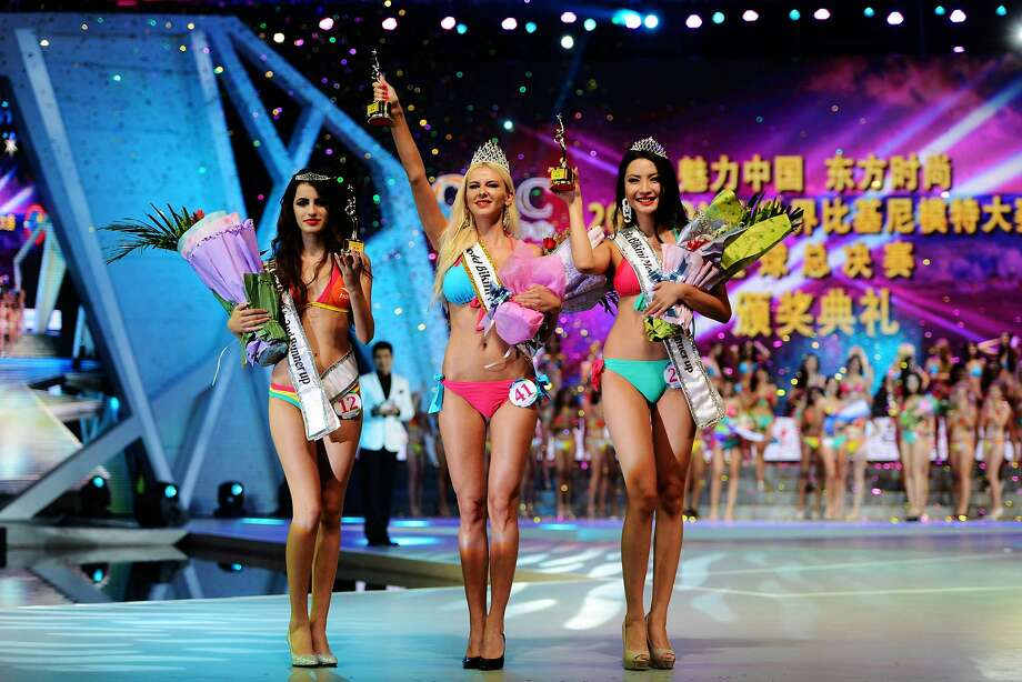 Release the white smoke! We have a World Bikini Model champion!She is the lovely Stetiarova   Martina of Slovakia (center). Second- and third-place runner-ups in the 2014 OMC World Bikini Model Contest in Qingdao,   China, respectively are Namshir Anu of Mongolia (right) and Karaj Hygertajfoe of Albania. Photo: Stringer, AFP/Getty Images