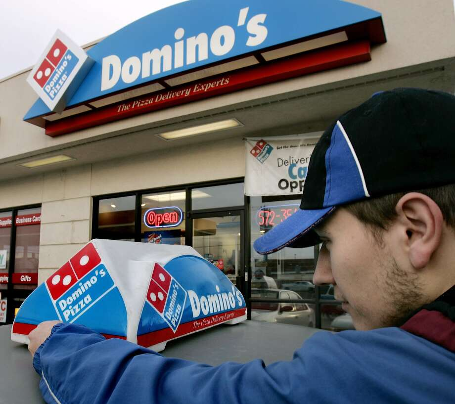 The Domino's Pizza chain says it has about 8,500 locally owned outlets. Photo: Douglas C. Pizac, Associated Press