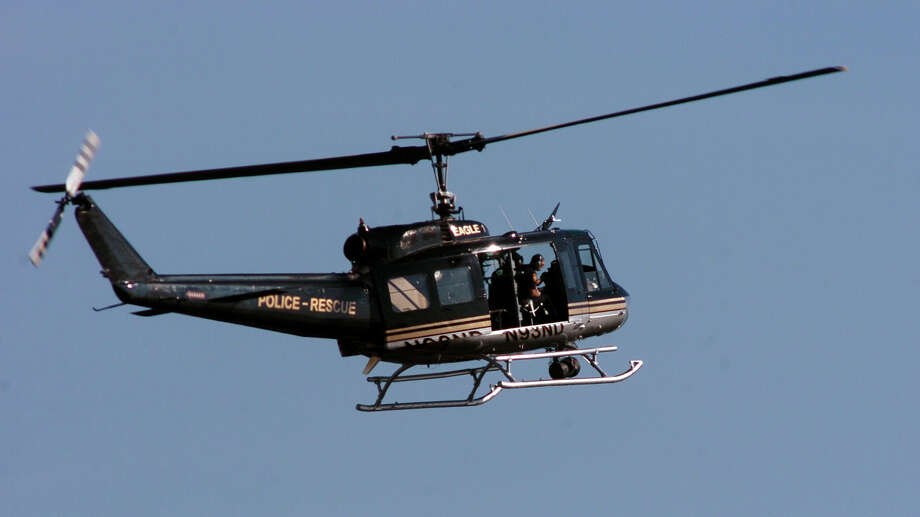 Eagle-1 takes part in manhunt for a fugitive in Milford, Conn. on October 7, 2011. A former U.S. Army UH-1 âÄúHueyâÄù helicopter, Eagle-1 is used as a search-andâÄìrescue aircraft by police department throughout Connecticut. Its operation is guided by a non-profit organization, the Nelson-DâÄôAncona Foundation, which relies on donations for its upkeep and operation costs. Photo: Christian Abraham / Connecticut Post