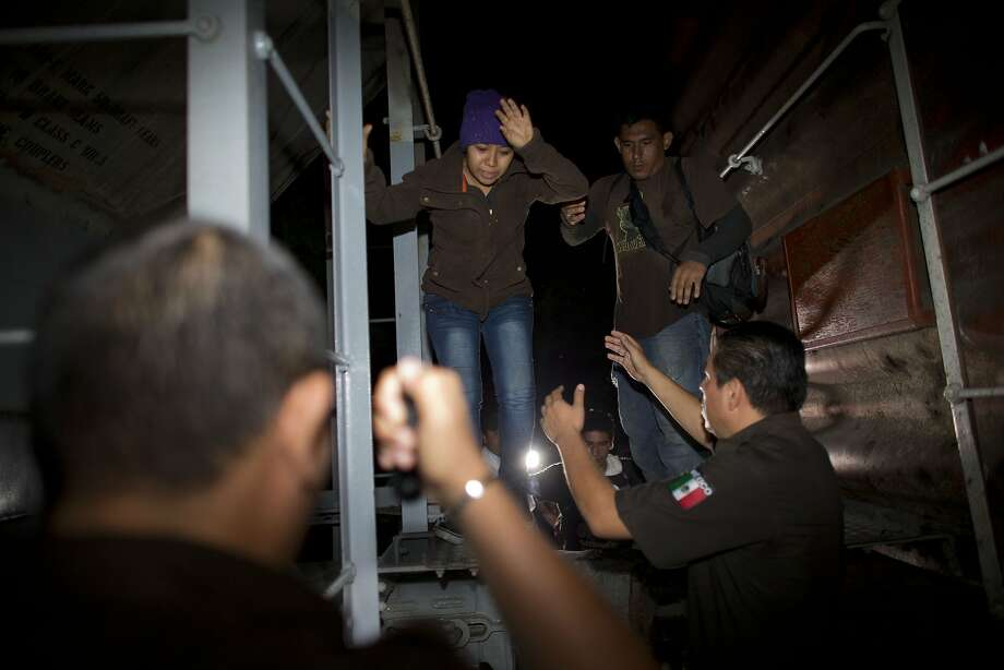 Immigration officials remove Central American migrants from a northbound freight train in San Ramon, Mexico. Photo: Rebecca Blackwell, Associated Press