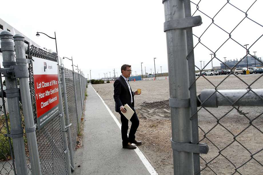 P.J. Johnston, media spokesman for the Golden State Warriors, checks out the site of the team's future arena on Third Street in San Francisco's Mission Bay. Photo: Sarah Rice, Special To The Chronicle