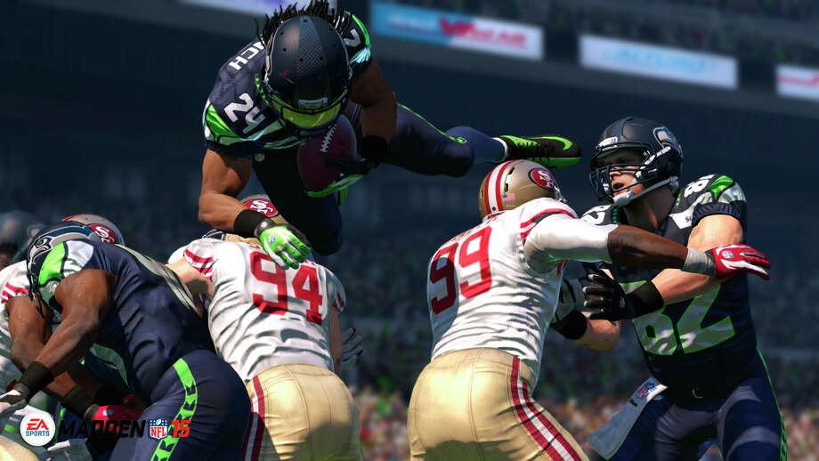 "In this photo provided by EA Sports, the Seattle Seahawks running back Marshawn Lynch leaps for yardage in ""Madden NFL 15"" (EA Sports, for the Xbox One, PlayStation 4, Xbox 360, PlayStation 3, $59.99). (AP Photo/EA Sports)  ORG XMIT: CAET517 / EA Sports"