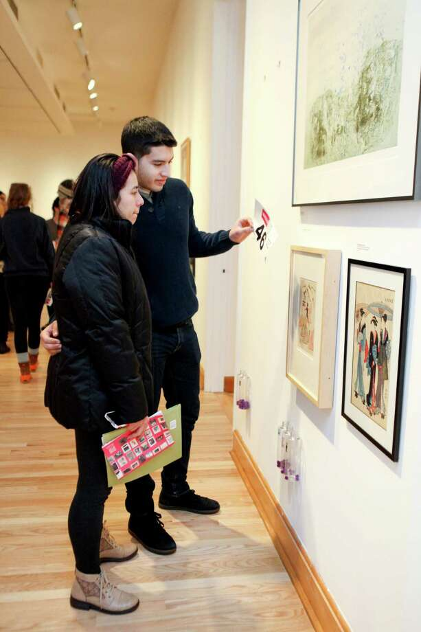Williams College students look over works of art as part of a program launched last spring that allows them to borrow pieces from the college art museum to display in their dorm rooms.