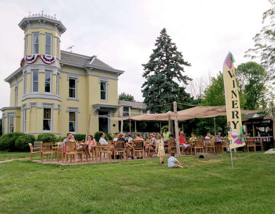 Put-in-Bay Winery is located in a Victorian house on the Doller Estate. It opened in 2009 and has a view of the harbor. (Gretchen McKay/Pittsburgh Post-Gazette/MCT) ORG XMIT: 1156252 Photo: Gretchen McKay / Pittsburgh Post-Gazette