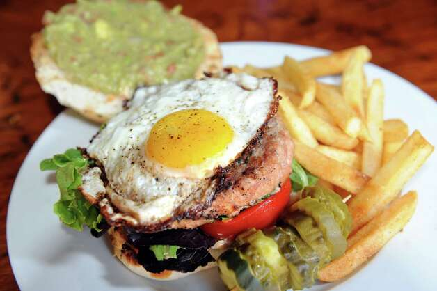 Napa Cowgirl Burger with in-house-made chipotle chicken burger topped with a fried egg on Tuesday, Aug. 19, 2014, at The Ruck in Troy, N.Y. (Cindy Schultz / Times Union) Photo: Cindy Schultz / 00028216A