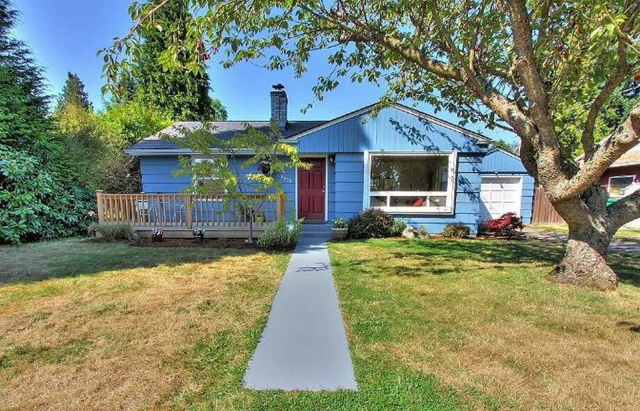 We'll start with the northernmost and lowest-priced home on our tour, 2308 N. 137th St., which is within half a mile of Ingraham High School and is listed for $296,000. The 1,059-square-foot house, built in 1948, has two bedrooms, one bathroom, a bonus room and a front deck on a 7,227-square-foot lot. Open houses are scheduled for 1 p.m. to 4 p.m. Saturday and Sunday. Photo: Courtesy Ken And Marilynn Balter/Windermere Real Estate