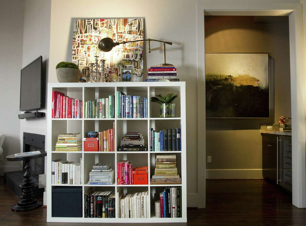 Properly arranged, bookshelves become visually interesting elements in room.