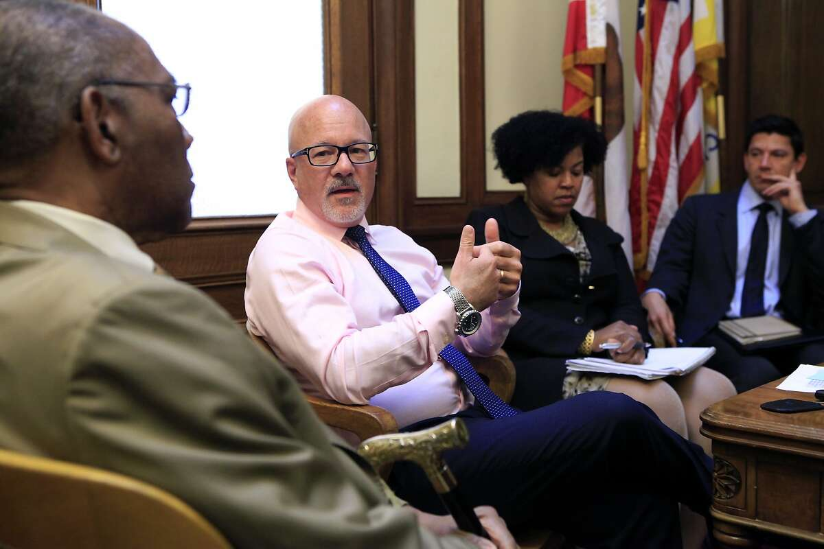 Steve Kawa, Chief of Staff to Mayor Ed Lee, center, speaks with Rev. Amos Brown of the NAACP and others during a meeting with African American community leaders on issues of housing and education, at City Hall in San Francisco, CA, Thursday, August 21, 2014.