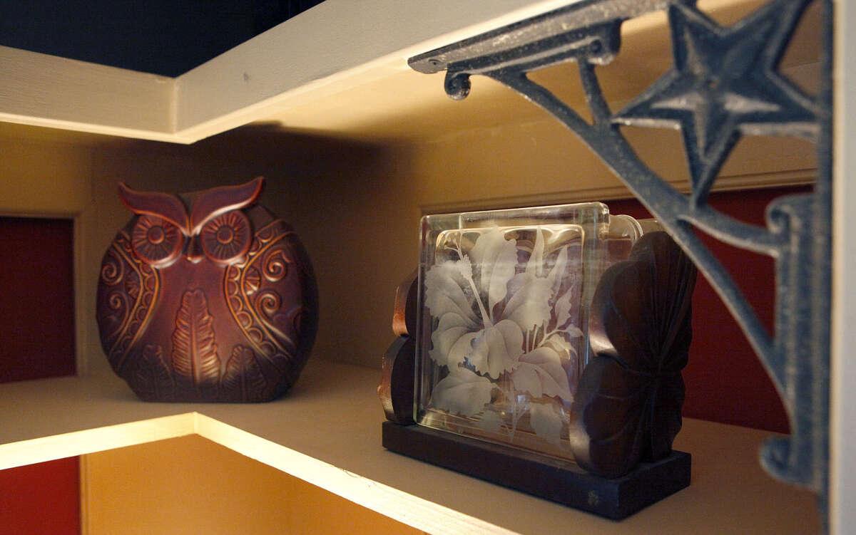 Professional organizer Cynthia Cunningham displays items that