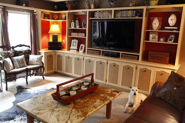 """Professional organizer Cynthia Cunningham decorates her bookshelves with items that are meaningful. """"That is my personal museum, a revolving memory wall,"""" she said. Shelves can be adjusted to fit changing needs."""