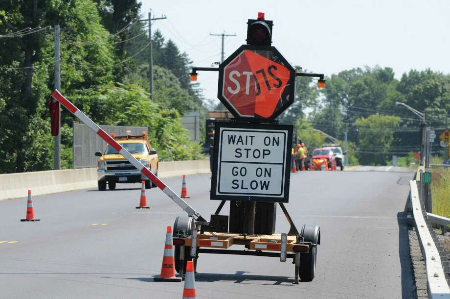 The arm of a mechanical flagger is raised and its sign turns from stop to slow as it manages traffic around a road construction site Monday, Aug. 25, 2014, on Route 23 in Catskill, N.Y. (Will Waldron/Times Union) Photo: WW / 00028309A