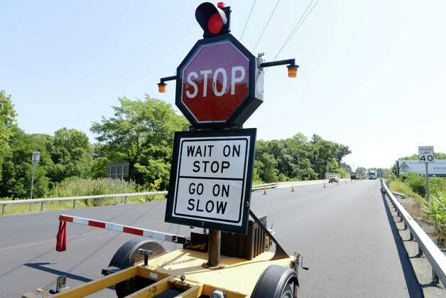 A mechanical flagger manages traffic around a road construction site Monday, Aug. 25, 2014, on Route 23 in Catskill, N.Y. (Will Waldron/Times Union) Photo: WW / 00028309A
