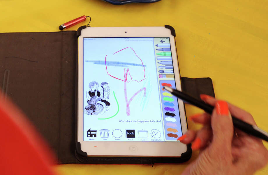 Art teacher Susan Striker displays her Anti-Coloring Book app on her iPad at the Cos Cob School where she teaches, Firday, Aug. 29, 2014. Striker said the app, that she created, encourages kids to take the creative lead with their art work. Photo: Bob Luckey / Greenwich Time