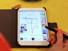 Art teacher Susan Striker displays her Anti-Coloring Book app on her iPad at the Cos Cob School where she teaches, Firday, Aug. 29, 2014. Striker said the app, that she created, encourages kids to take the creative lead with their art work.