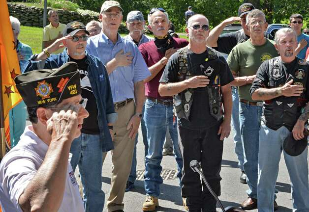 Gene Ratigliano, left, leads Vietnam-era veterans from around the region in the Pledge of Allegiance during a ceremony at Congress Park Friday, Aug. 29, 2014, in Saratoga Springs, N.Y.  (John Carl D'Annibale / Times Union) Photo: John Carl D'Annibale / 00028342A